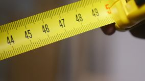 Roll of measuring tape - macro stock footage