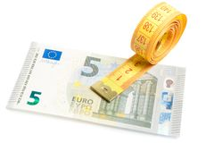 Roll of measuring tape on new five euro banknote Royalty Free Stock Images