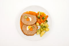 Roll of meat and vegetables. Top view. Selective Focus White background stock photo