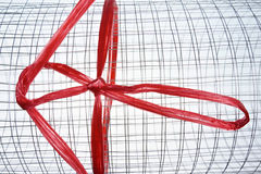 Roll of metal net with red plastic rope Stock Photo