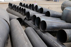 A roll of metal pipeline, wait in construction. stock image