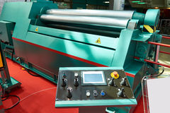 4-roll metal sheet bending machine with control panel. 4-roll metal sheet bending machine with CNC Royalty Free Stock Photography
