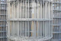 Roll of metal wire. Piles of roll of metal wire inside of warehouse for construction materials Stock Photo
