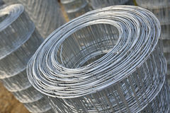 Roll of metal wire. Stacked inside of warehouse for construction materials Royalty Free Stock Photo