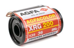 A roll of 35mm camera film. NIEDERSACHSEN, GERMANY MAY 30, 2018 : A roll of AGFA XRG 200 35mm analogue camera film on a white background royalty free stock images
