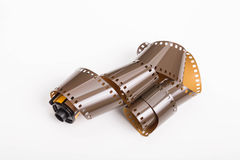 Roll of 35mm Film on White. A roll of old 35mm photographic film on a white background royalty free stock images