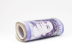 Roll Of Money. £280 British Pounds Sterling in a roll. Twenty Pound notes. Copy space if required stock photo