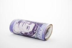 Roll Of Money. £280 British Pounds Sterling in a roll. Twenty Pound notes. Copy space if required Royalty Free Stock Image
