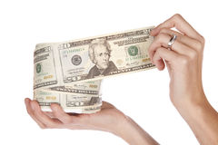 Roll of money. A woman is unrolling a big roll of money Royalty Free Stock Image