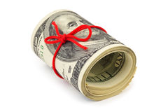 Roll of money and bow Royalty Free Stock Photography