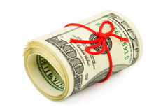 Roll of money and bow Royalty Free Stock Image