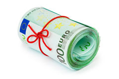 Roll of money and bow Royalty Free Stock Photos