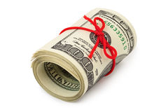 Roll of money and bow Royalty Free Stock Images