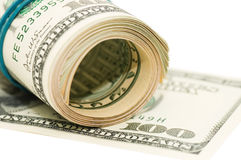 Roll of money and bow still life Royalty Free Stock Photos