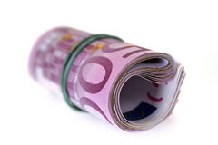 Roll of money and bow Stock Photography