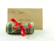 Roll of money for daddy Royalty Free Stock Images
