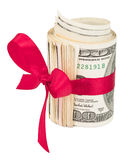 Roll of money with a red bow Royalty Free Stock Photo