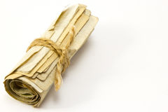 Roll of money tied with a rope Stock Photo