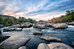 Roll on a mountain river among the stones Royalty Free Stock Photography