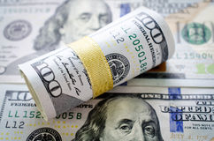 Roll of  New One hundred dollars Royalty Free Stock Photos