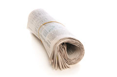 Roll of Newspaper. Isolated on a white background royalty free stock image