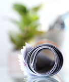 Roll of newspaper. On the table stock photos
