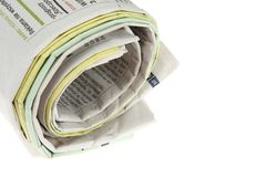 Roll of newspapers Stock Images