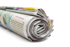 Roll of newspapers. Isolated on white background royalty free stock image
