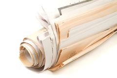 Roll of Newspapers. On White Background Stock Photos