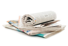 Roll of newspapers, isolated on white. Background stock photos