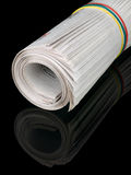 Roll of newspapers Stock Photo