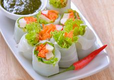 Roll noodles with vegetable and sauce on white plate royalty free stock image