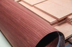 Roll of oak veneer. And furniture blanks for veneering Royalty Free Stock Photo