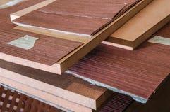 Roll of oak veneer. And furniture blanks for veneering Royalty Free Stock Image