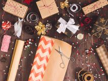 Free Roll Of Kraft Wrapping Paper With Scissors For Cutting Packing Christmas Gift Box Royalty Free Stock Images - 102495469