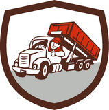 Roll-Off Bin Truck Driver Thumbs Up Shield Cartoon. Illustration of a roll-off bin truck driver smiling with thumbs up viewed from front set inside shield crest royalty free illustration