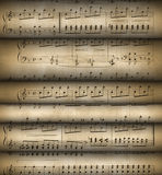 Roll old musical notes. Musical notes. The grant for play on musical instruments Royalty Free Stock Photo