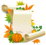 Roll of old paper and autumn leaves Stock Photo