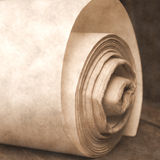 Roll old paper. On wooden table Stock Photos