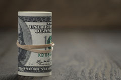 Roll of old style hundred dollar bills stand on Royalty Free Stock Photos