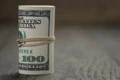 Roll of old style hundred dollar bills stand on Stock Image