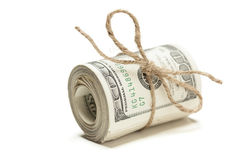 Roll of One Hundred Dollar Bills Tied in Burlap String on White. Roll of One Hundred Dollar Bills Tied in Burlap String Isolated on a White Background Stock Image