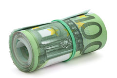 Roll of one hundred euro banknotes. Roll of one hundred euro banknotes with a rubber band, isolated on the white background, clipping path included. Full focus Stock Images