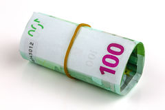 Roll of one hundred euro banknotes. With a rubber band, isolated on the white background, clipping path included. Full focus Stock Image