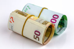 Roll of one hundred euro and Fifty banknotes Stock Photo