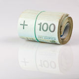 Roll of one hundred polish zloty Royalty Free Stock Photo