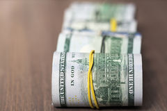 A roll of one hundred US dollar bills Stock Photos