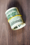 A roll of one hundred US dollar bills Stock Image