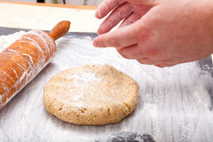 Roll out the biscuit dough on the baking mat Royalty Free Stock Photo
