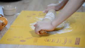 Roll out the dough. Female hands roll the dough. HD stock video footage